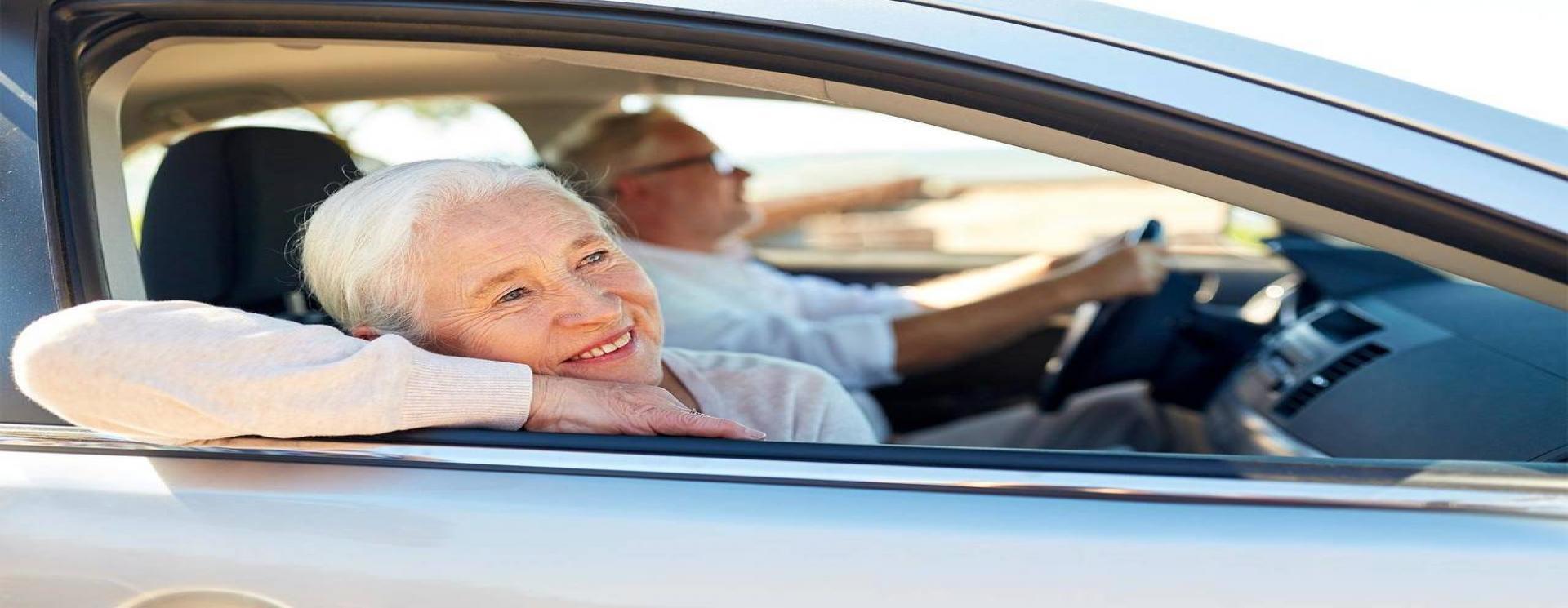 Senior persons hiring a car