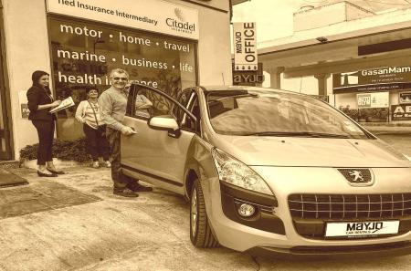 Happy customer leasing a car